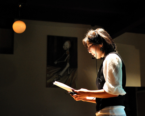 Larissa Min reading a creative nonfiction manuscript at Halo, in the Capitol HIll neighborhood of Seattle.